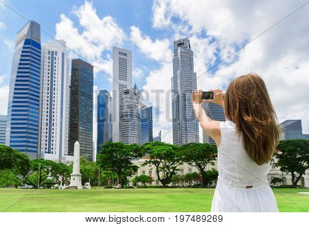 Girl With A Smartphone Taking A Picture Of Beautiful Cityscape