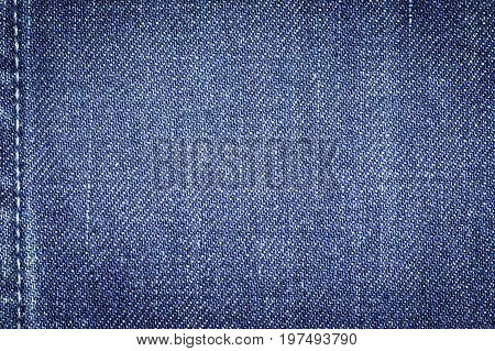 Denim jeans fabric texture background with seam for beauty clothing / fashion business design and industrial construction idea concept.