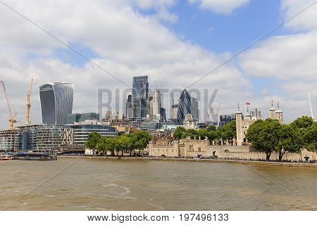 LONDON UNITED KINGDOM JUNE - 22 2017: London's primary financial district City of London modern office buildings Gherkin. As of 2017 there are 17 skyscrapers in London that reach a roof height of at least 150 meters