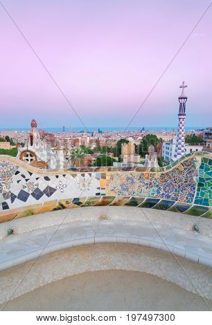 Gaudi bench and cityscape of Barcelona from park Guell at sunset, Catalonia Spain