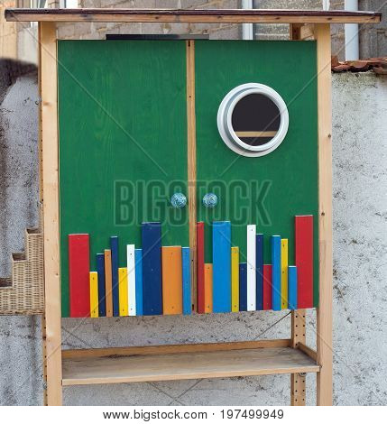 A small outdoor colorful book case, close up