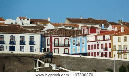 Long shot of colorful houses in the port and the city Angra do Heroismo, Terceira island, Azores islands. Good for postcards