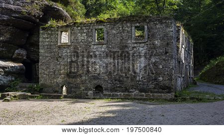 Dolský mlýn. Old building. Ruin of an old mill building. Dolsky mill in national park with old ruin of mill in north Bohemia.