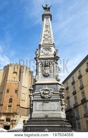 Naples, Italy - may 18, 2017: Church San Domenico Maggiore was founded in the 13th century by the friars of the Dominican Order and statue of Saint Dominic in Piazza San Domenico Maggiore in Naples, Italy