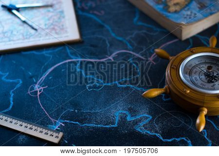 Barometer on a black background with a map