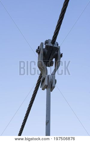 Wire rope with custom made attachments used in the construction of a swing bridge. Incorporating a wire rope clamp housed in monkey plates which connect to an eye bolt.