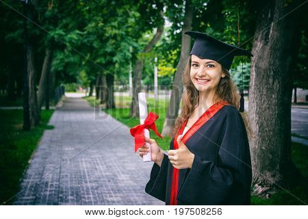 Woman portrait on her graduation day. University. Education graduation and people concept.