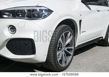 Sankt-Petersburg Russia July 21 2017 BMW X5 M Perfomance. Tire and alloy wheel. Headlight. Front view of a white modern luxury sport car. Car exterior details. Photo taken on test-drive July 21