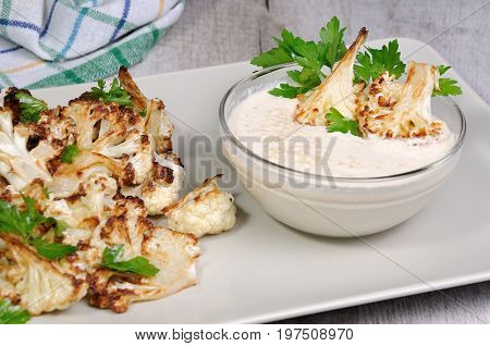 Roasted cauliflower with tahini sauce (sesame paste)
