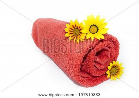 Red Towel Rolled Up With 3 Gazanias