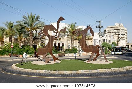 BEER SHEVA ISRAEL - JUNE 14 2017: City sculpture in the form of two stylized horses at a circular crossroads