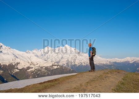 Traveler Is Standing On The Mountain Road