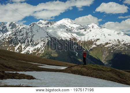 Traveler Is Standing On The Mountain Slope