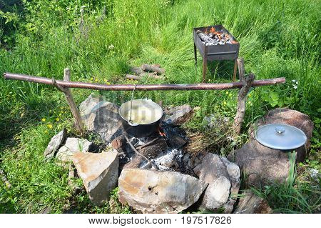 Cooking in the cauldron on the open fire. Outdoor cooking.