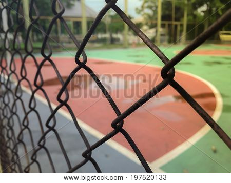 Tennis court - viewed from the ground level/Steel mesh fence of the tennis courts