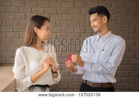 marriage proposal, man give ring to his girl, young happy couple romantic date , celebrating valentine day