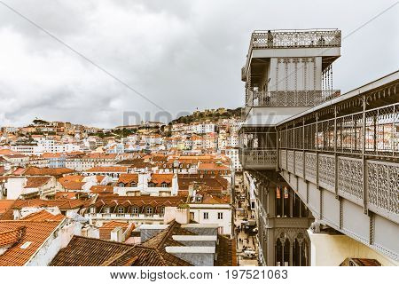 Lisbon panoramic view from Santa Justa lift. Moody view of the capital city of Portugal on a rainy day. Travel and architecture concepts
