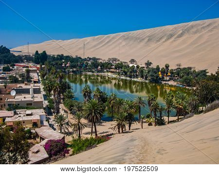 Huacachina oasis rounded by sand and dunes Peru