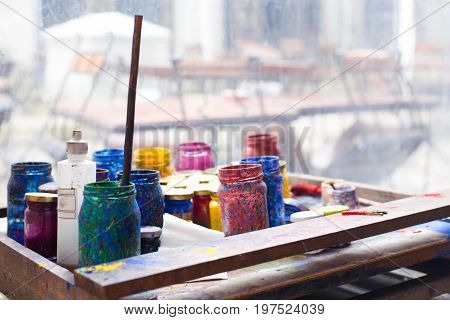 Color Jars And Tempera On Working Table In Ceramic Laboratory In Turkey