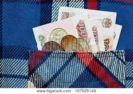 Symbol of poverty and financial crisis concept - just less then 10 US dollars in russian rubles currency in work shirt pocket