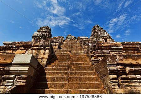 SIEM REAP CAMBODIA - DECEMBER 29 2016: Ascent to the top of hinduism temple in Angkor ancient complex