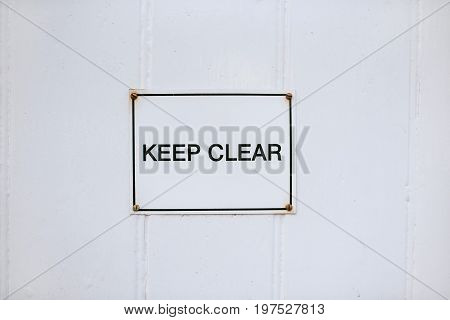 Metal keep clear sign on withe background