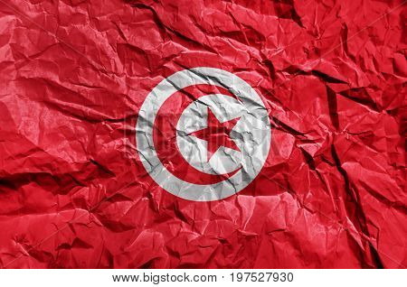 Tunisia flag painted on crumpled paper background