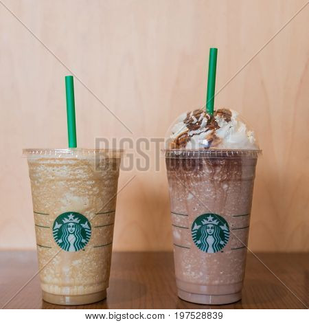 Bangkok Thailand - June 10 2017: Cup of Starbucks Espresso Frappuccino and Chocolate Frappuccino with whipped cream in Starbucks coffee shop for promotion buy 1 get 1 free. (Selective focus)