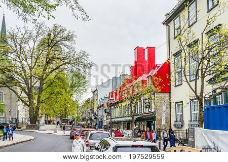 Quebec City Canada - May 29 2017: Old town Sainte Anne street with restaurants by place d'arms park by Chateau Frontenac with people walking
