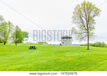 Quebec City Canada - May 30 2017: Martello tower watchtower in plaines d'Abraham with green grass field