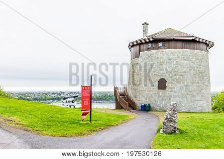 Quebec City Canada - May 30 2017: Martello tower watchtower in plaines d'Abraham with sign and cannon overlooking the Saint Lawrence river