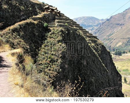 Path to Inca ruins on hillside at Pisac, Peru