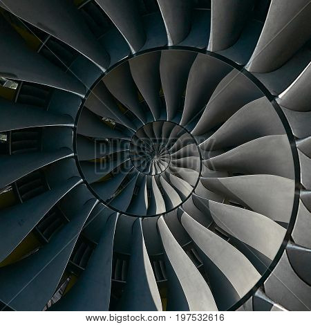 Turbine blades wings spiral effect abstract fractal pattern background. Spiral industrial production metallic turbine background. Turbine manufacturing technology abstract fractal pattern stair