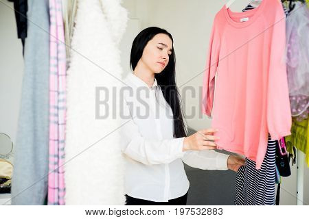 Frustrated young woman cannot decide what to wear poster