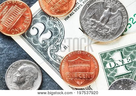 Close Up Picture Of United States Dollar Banknotes And Coins.