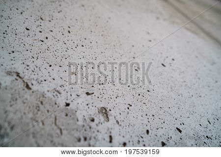 angle shot of new concrete wall with shallow focus, high detailed photo