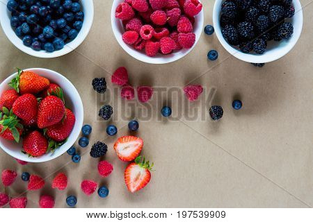 Small White Bowls Filled With Ripe Berries.