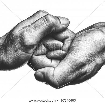 Male and female hand united in handshake. That could mean help guardianship protection love care etc. Black and white image on white isolated background.