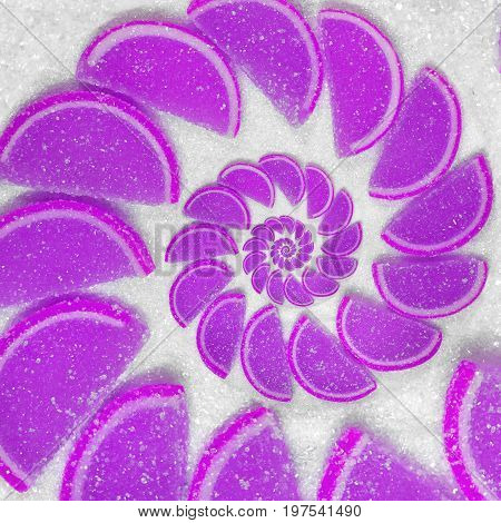 Abstract fruit jelly wedges violet magenta cantle lobule on white sugar background. Violet jellies. Sweet fruit segments. Juicy fruit jelly on sugar sand Abstract food fractal Exotic sweets background
