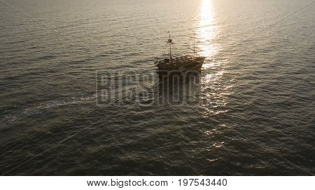 An Old Wooden Ship Sails In The Open Ocean
