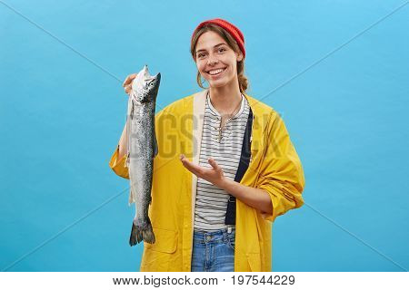 Look At This! Happy Female Angler Holding Long Big Fish Showing With Hand Her Big Catch While Posing