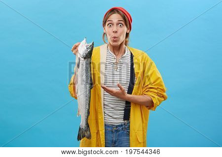 Just Have Look At This! Young Astonished Fisherwoman Wearing Casual Clothes Returning From Fishing T