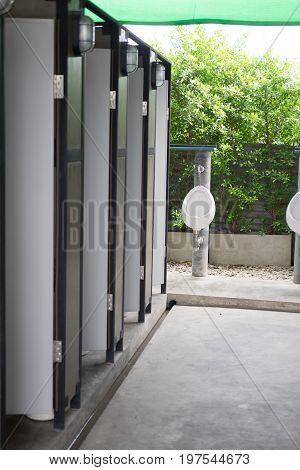 row of outdoor urinal men public toilet white urinals in men bathroom