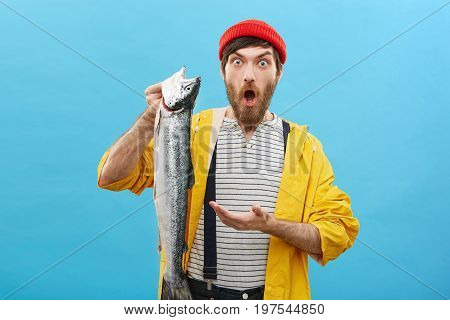 I Can`t Believe My Eyes! Surprised Bearded Fisherman Looking At Camera With Widely Opened Eyes And M