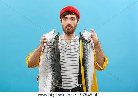 People, Recreation And Fishing Concept. Young Male Angler With Blue Eyes Having Thick Beard And Must