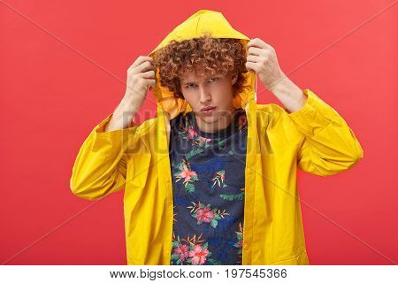 Handosme Young Caucasian Hipster With Curly Ginger Hair Adjusting Hood Of His Yellow Fashionable Ano