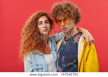 People, Relationships, Style, Fashion And Modern Lifestyle. Studio Portrait Of Two Male And Female B