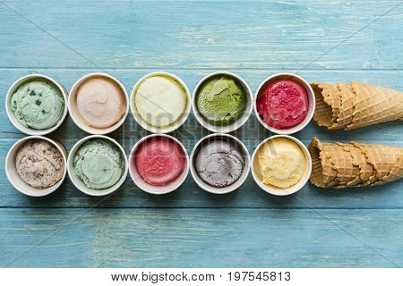 Top view of Ice cream flavors in cup and ice cream cone waffle sweet and dessert food concept