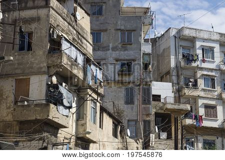 Abandoned houses and balconies with laundry of Tripoli, Lebanon