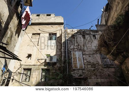 abandoned backyard with laundry in the streets of Tripoli, Lebanon